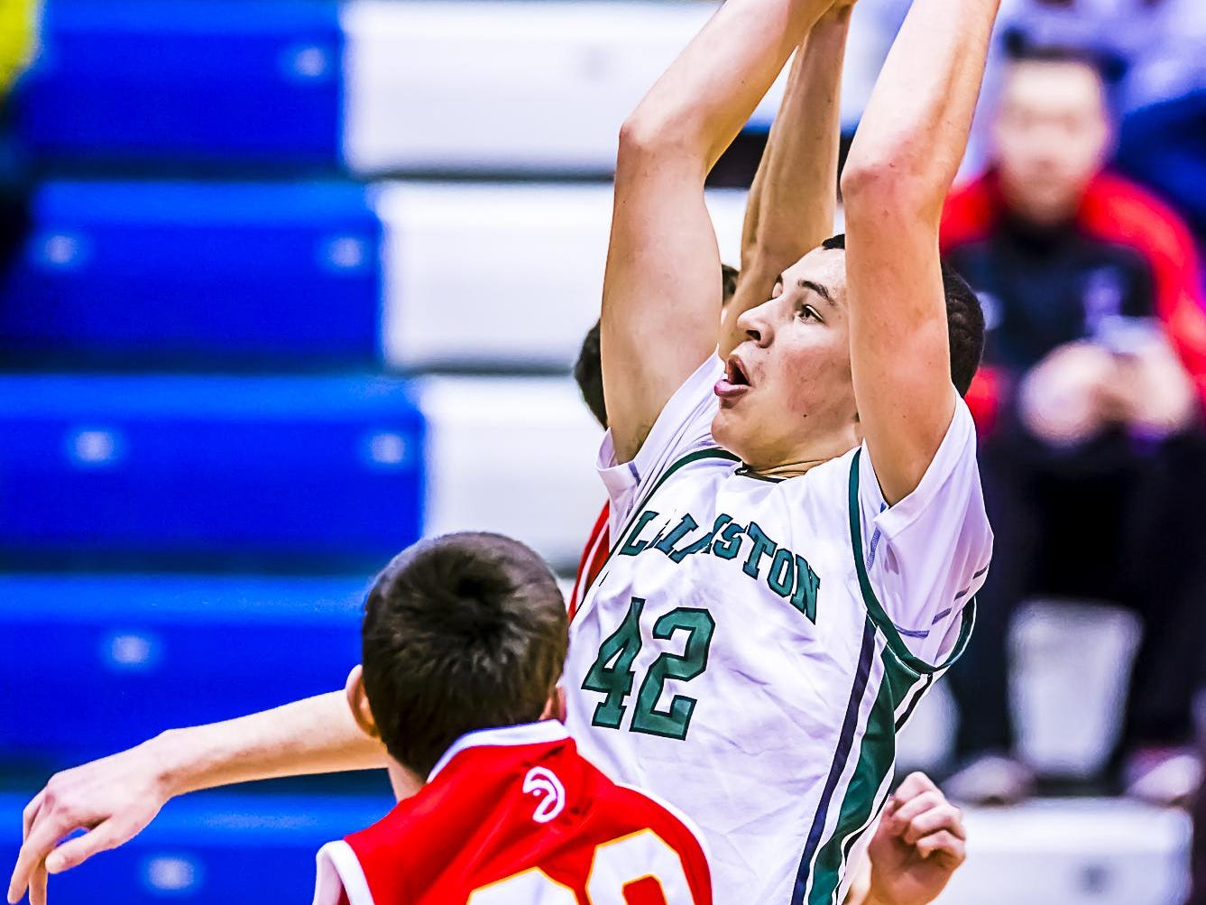Sean Cobb ,42, of Williamston grabs an offensive rebound over Justin Koch ,33, of Troy Athens during their Holiday Hoops Invitational game Tuesday December 29, 2015 at Lansing Community College. KEVIN W. FOWLER PHOTO