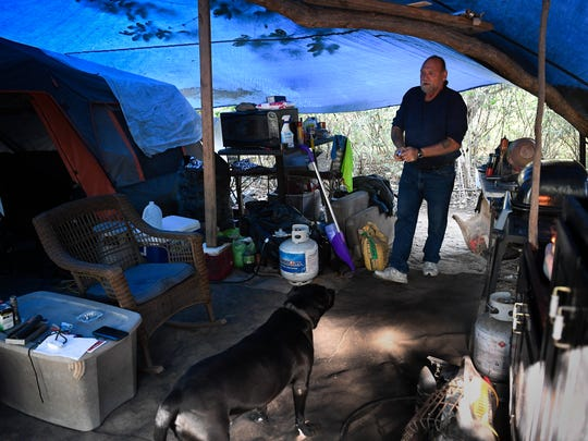 Wendell Segroves spends time with his dog Argo at his campsite Wednesday, Oct. 18, 2017, in Nashville. Segroves has been homeless since 2004 and serves on the Metro Homelessness Commission.