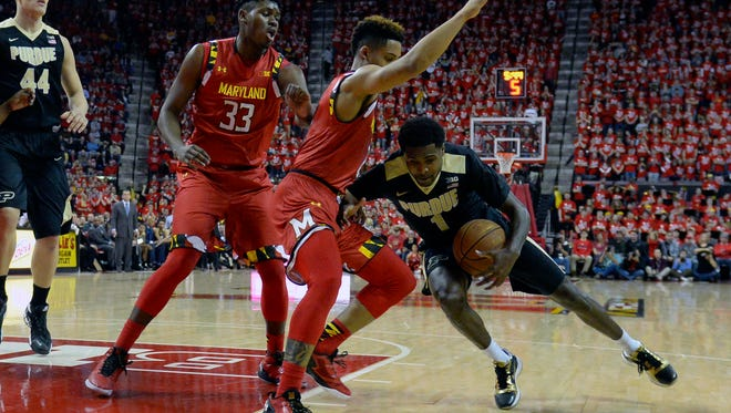 Purdue Boilermakers guard Johnny Hill (1) falls as he dribbles in front of Maryland Terrapins guard Melo Trimble (2) during the first half at Xfinity Center.