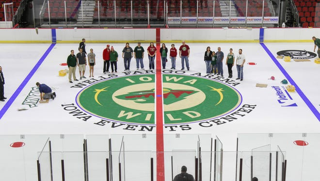 Iowa Wild season-ticket holders were given a chance to paint part of the ice at Wells Fargo Arena.