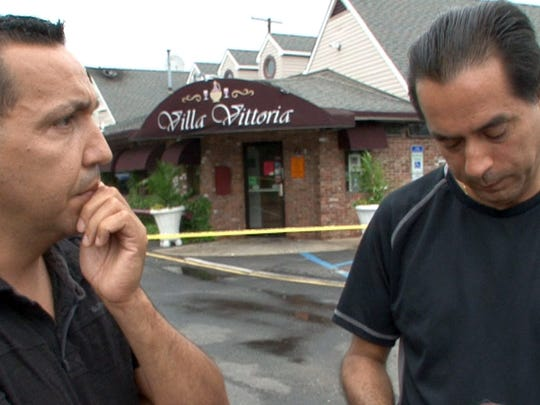 Villa Vittoria restaurant co-owners Dago Segura (left) and Nelson Monroy speak Tuesday, July 5, 2016, about the fire that heavily damaged their Brick Township restaurant the previous day.