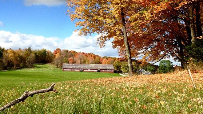 Fall foliage lights up the landscape in Brandon, a short drive across dirt roads from Hubbardton.