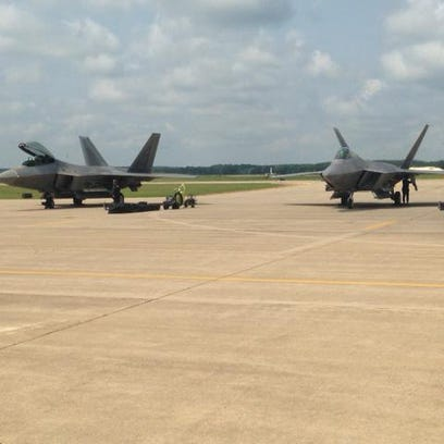 Two U.S. Air Force F-22 Raptor fighters sit on the tarmac at W.K. Kellogg Airport this morning after arriving to prepare for this weekend's air shows at the Field of Flight.