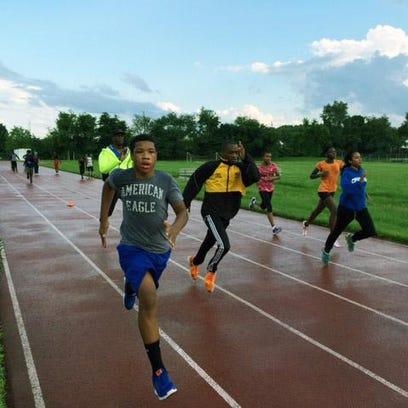 Members of the Delaware Elite Track Club practice Monday night at Newark High School.