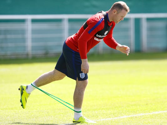 England's Wayne Rooney stretches during a training session in Chantilly, France, Thursday, June 23, 2016. England will face Iceland in a Euro 2016 round of 16 soccer match in Nice on Monday, June 27. (AP Photo/Kirsty Wigglesworth)
