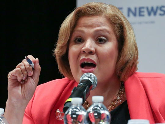 Wilmington mayoral candidate Maria Cabrera declares the need for a woman as mayor during a debate of seven candidates at the Grand Opera House Thursday.