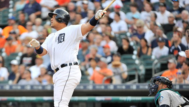Tigers' Miguel Cabrera hits a two-run home run in the first inning against the Seattle Mariners at Comerica Park in Detroit.
