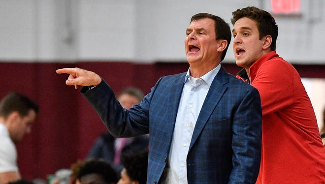 Brentwood Academy coach Hubie Smith works with his team against MBA during the second half at Montgomery Bell Academy in Nashville, Tenn., Thursday, Jan. 25, 2018.
