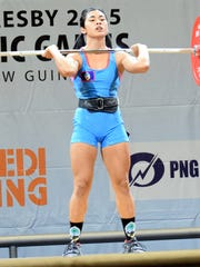 Kimberly Taguacta competes in weightlifting at the