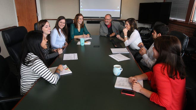 Bill Murtha, CEO at Roberts Communications, meets with a group of younger employees.