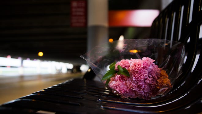 A single bouquet of flowers rests on a bench outside the Terminal 2 baggage claim Sunday at Fort Lauderdale-Hollywood International Airport.