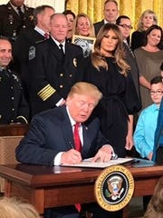 Knoxville Police Chief David Rausch stands behind President Donald Trump in October, 2017, as Trump declares the opioid epidemic a national public emergency. Rausch was among those invited to the White House for the announcement.