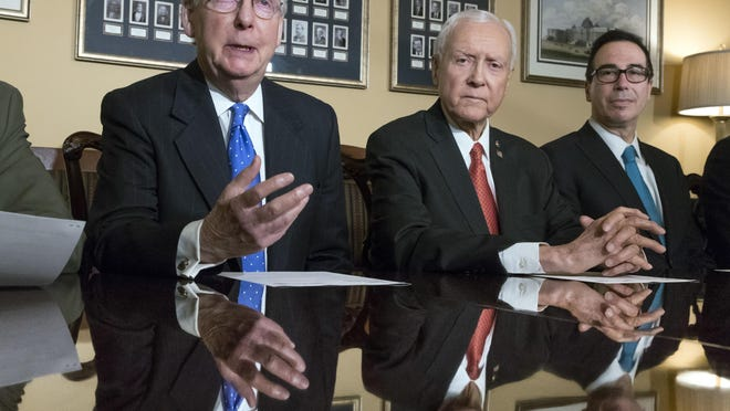 From left, Senate Majority Leader Mitch McConnell, R-Ky., Senate Finance Committee Chairman Orrin Hatch, R-Utah, and Treasury Secretary Steven Mnuchin, speak to reporters on Nov. 9, 2017, as work gets underway on the Senate's version of the GOP tax reform bill, on Capitol Hill in Washington.