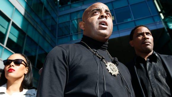 Civil-rights activist the Rev. Jarrett Maupin holds