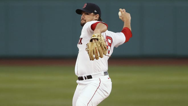 Red Sox starter Zack Godley delivers a pitch against the Phillies during the first inning of Tuesday night's game at Fenway Park.