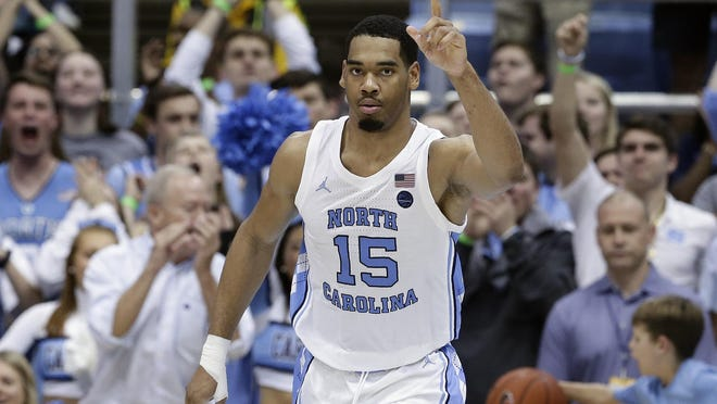 Garrison Brooks thanks a North Carolina teammate for a pass during his 35-point effort against Georgia Tech last season in Chapel Hill.