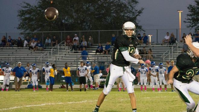 Viera High's Timothy DeMorat (12) fires off a pass.