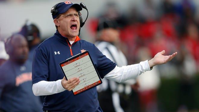 Auburn head coach Gus Malzahn yells at an official during the first half of an NCAA college football game against Georgia Saturday, Nov. 12, 2016, in Athens, Ga. (AP Photo/John Bazemore)