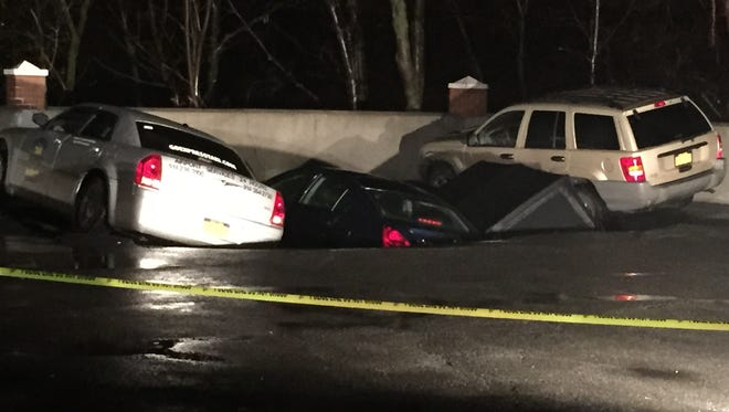 Four cars were caught in a sinkhole in an Ossining parking lot Tuesday night.
