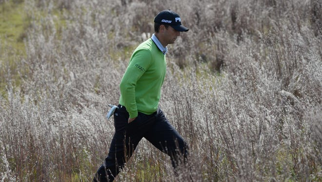 Luke Guthrie of the USA leaves the green at the 7th hole during the third round of the BMW Shanghai Masters.