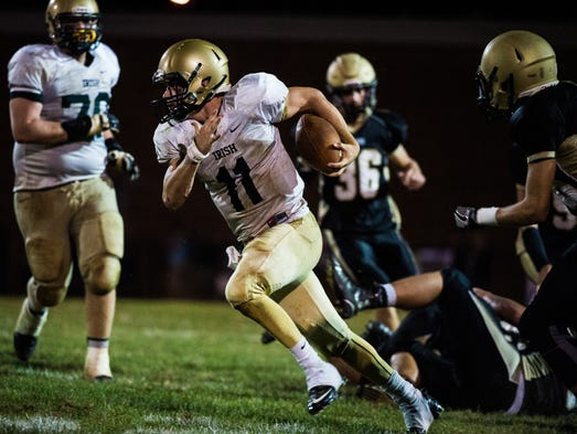 York Catholic's Daniel Yokemick runs the ball against