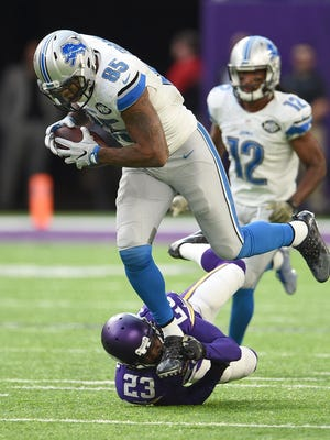 Lions tight end Eric Ebron breaks a tackle by the Vikings' Terence Newman during Detroit's overtime win Sunday, Nov. 6, 2016.