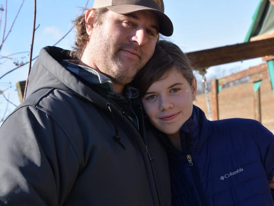 Ryan Blosser with his daughter Kai Marley at their