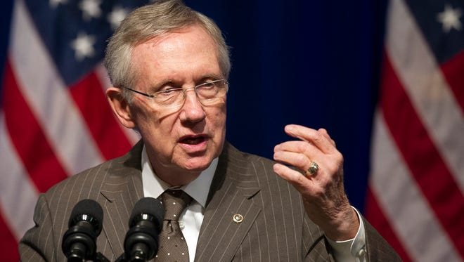 Senate Majority Leader Harry Reid, D-Nev., addresses an Organizing for Action summit in Washington, D.C., on Monday, July 22, 2013. In an interview, Reid speaks candidly about Russian President Vladimir Putin.