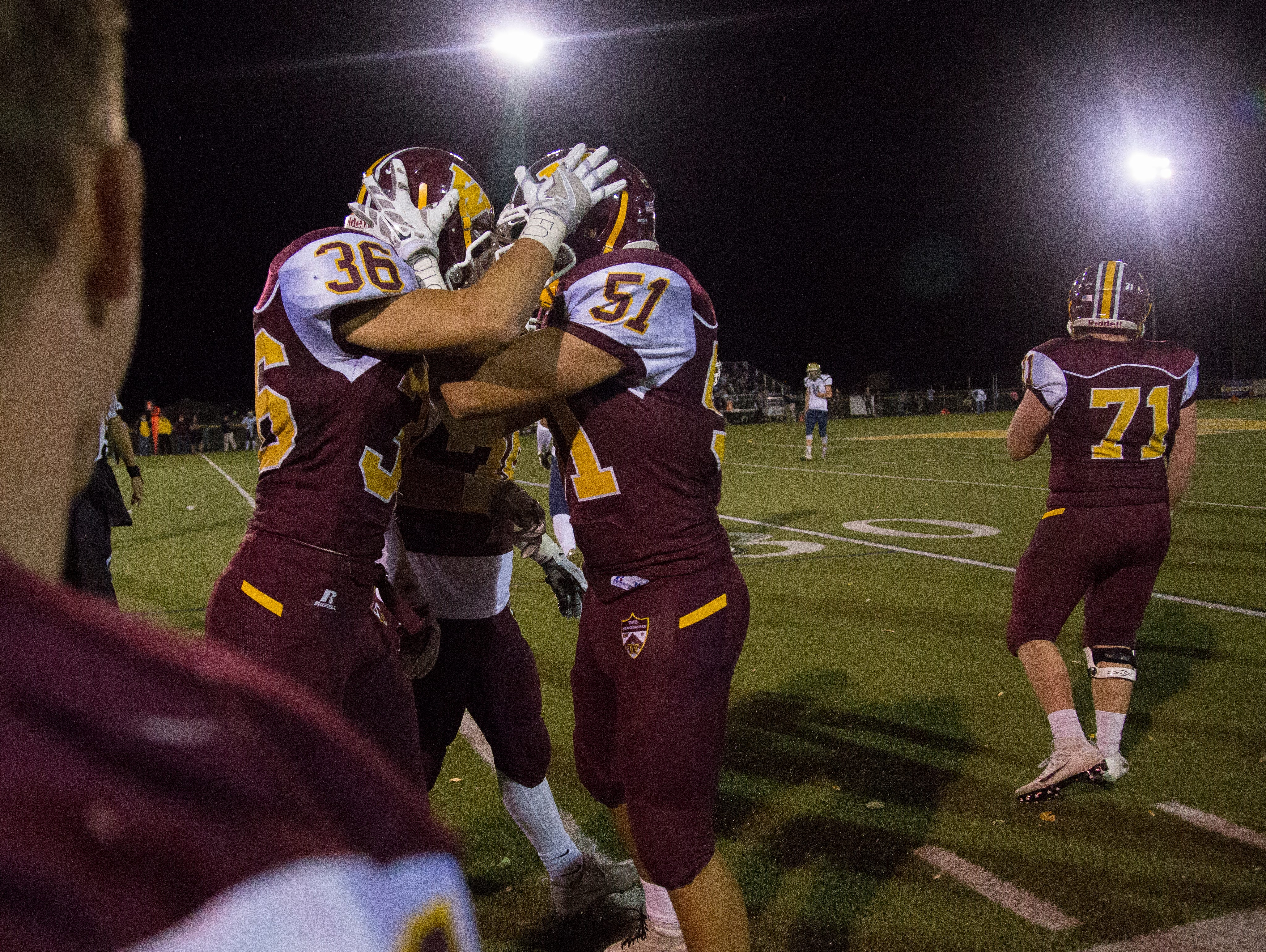 Windsor linebacker Jake Sorrentino, right, celebrates a touchdown with linebacker Joel Kopcow during the game against Greeley West Friday, September 23, 2016.
