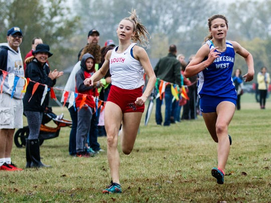 Waukesha South's Grace Dargiewicz edges out Waukesha West's Kaya Kuokkanen for fourth place in the Classic 8 Conference Championship cross country meet at Lake Denoon Middle School in Muskego on Saturday, Oct. 14, 2017.