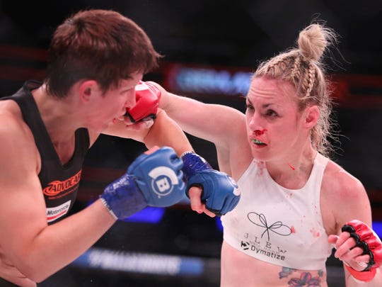 Heather Hardy, right, in action against Alice Yauger in a mixed martial arts bout at Bellator 180 on Saturday, June 24, 2017, in New York. Hardy won via 3rd round TKO. (AP Photo/Gregory Payan)