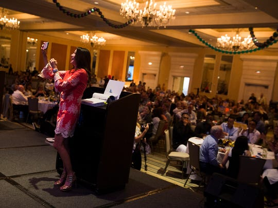 Amy Oshier takes a selfie with the crowd during the Choice Awards presented by the Naples Daily News on Thursday, July 27, 2017, at the Naples Grande Beach Resort.