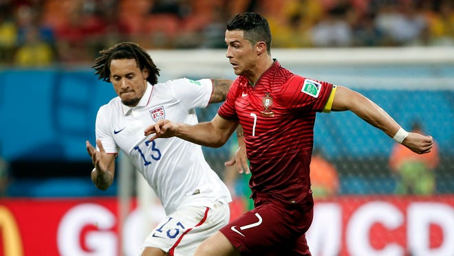 United States midfielder Jermaine Jones (13) chases after Portugal forward Cristiano Ronaldo (7) during the second half of a 2014 World Cup game at Arena Amazonia.