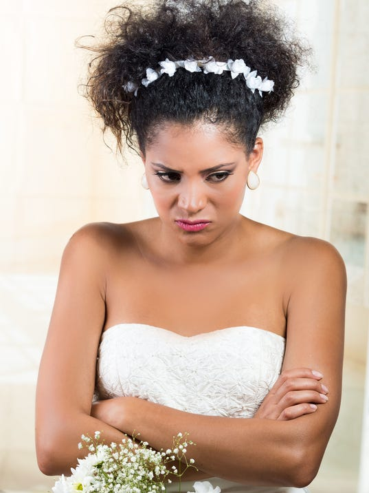 Portrait of beautiful exotic emotional bride looking angry