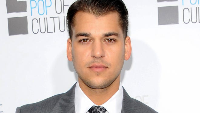 "In this April 30, 2012 file photo, Rob Kardashian from the show ""Keeping Up With The Kardashians"" attends an E! Network upfront event in New York. Rob Kardashian says in an Instagram post Saturday, Dec. 17, 2016 that fiancee Blac Chyna has left him and taken their month-old daughter with her."