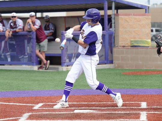 Wylie's Sam King (33) makes contact with a pitch during