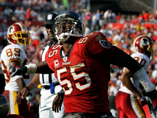 FILE - In this Nov. 25, 2007 file photo, Tampa Bay Buccaneers' Derrick Brooks reacts after the defense stopped the Washington Redskins on a fourth and inches during the third quarter of an NFL football in Tampa, Fla. Brooks will be inducted into the Pro Football Hall of Fame Saturday, Aug. 2, 2014, in Canton, Ohio. (AP Photo/Chris O'Meara, File)