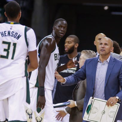 Bucks coach Jason Kidd, right, talks with team members John Henson (31) and Thon Maker during the second half of the team's NBA preseason basketball game against the Dallas Mavericks in Madison.