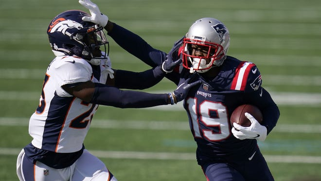 New England wide receiver Isaiah Zuber tries to elude Denver cornerback Michael Ojemudia in the first half of Sunday's game.