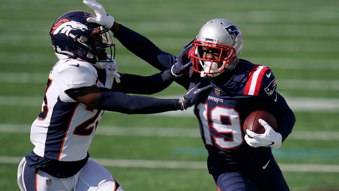 New England Patriots wide receiver Isaiah Zuber (19) tries to elude Denver Broncos cornerback Michael Ojemudia, left, in the first half of an NFL football game, Sunday, Oct. 18, 2020, in Foxborough, Mass.