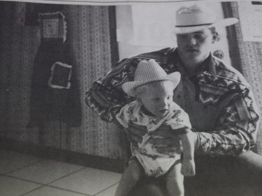 Leslie Ricketts holds his little brother Wayde Patsy Ricketts of Morganfield in August of 1995.