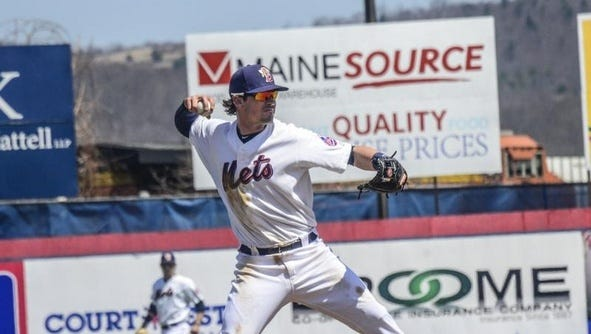New York Mets minor league infielder Matt Reynolds makes a throw to first base while playing for the Binghamton Mets during a game at NYSEG Stadium.