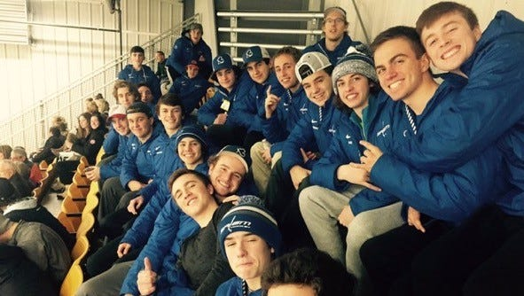 Salem's varsity boys hockey team enjoys watching the Adrian Bulldogs play in a NCAA Division III game at Arrington Ice Arena.