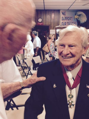Jack Hamlin, who saved dozens of men's lives on D-Day, was honored on Sunday.