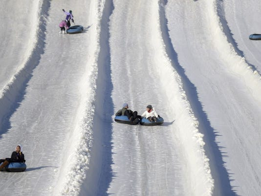 Snow tube riders at Avalanche Express in York County.