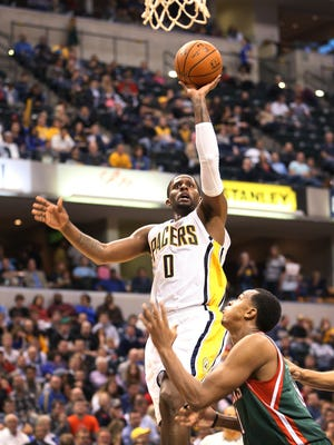 Pacer C.J. Miles goes up with a shot in the first half against the Bucks. Indiana hosted Milwaukee at Bankers Life Fieldhouse on Tuesday, November 4, 2014.