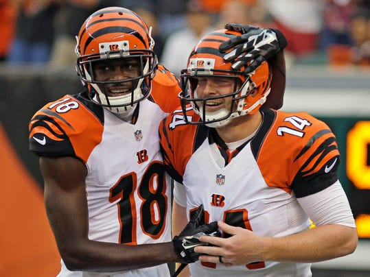 Cincinnati Bengals wide receiver A.J. Green (18) congratulates quarterback Andy Dalton (14) after Dalton threw a 43 yard touchdown pass to Mohamed Sanu in the first half of an NFL preseason football game against the New York Jets, Saturday, Aug. 16, 2014, in Cincinnati. (AP Photo/Tony Tribble)