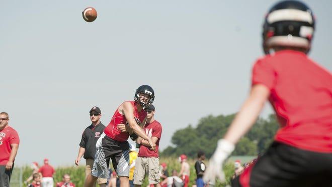 Bucyrus high School quarterback Gavin Lewis makes a perfect throw.