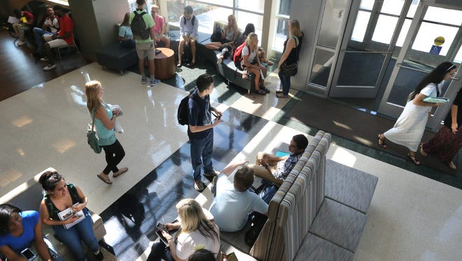 Students wait in the lobby for classes and to talk to advisors on the first day of class at Motlow State Community College Smyrna Center, on Monday, Aug. 24, 2015, the first day of classes. Because of the Tennessee Promise Students, enrollment is up making the Smyrna Campus the largest of the Motlow campuses.