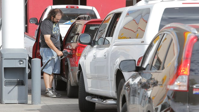 Motorists lined up four deep for cheap fuel at the Shell station at Saul Kleinfeld and Montana Ave. where it was priced $2.029.